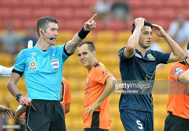Harry Ascroft of the Mariners is given a red card and sent from the field by referee Matthew Conger during the round 18 ALeague match between the...