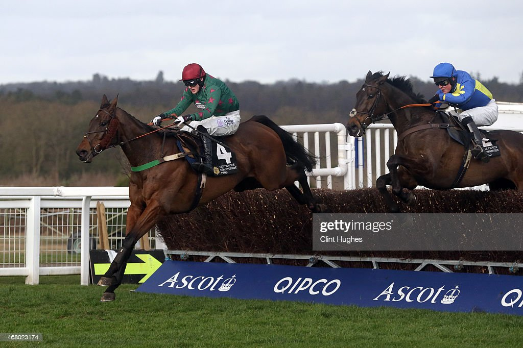 Harry Bannister riding Calgary Bay (L) clears the last fence and wins the Sir Ray Tindle Open Hunters Steeple Chase at Ascot Racecourse on March 29, 2015 in Ascot, England.