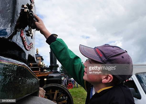 Harry Barker helps to clean the steam engine the Pride of Harwood at the annual Duncombe Park Steam Fair on July 3 2016 in Helmsley England Held in...