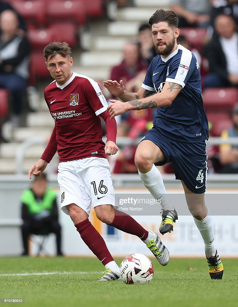 Harry Beautyman of Northampton Town and Anthony Wordsworth of Southend United look to the ball during the Sky Bet League One match between Northampton Town and Southend United at Sixfields on September 24, 2016 in Northampton, England.