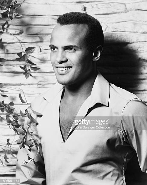 Harry Belafonte, closeup in open necked shirt. Undated photo.