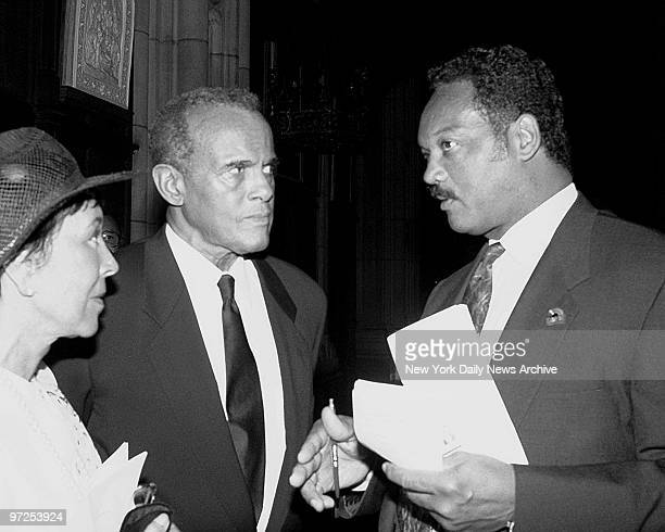 Harry Belafonte wiith his wife and Rev Jesse Jackson attend the funeral of Cleveland Robinson Belafonte and Jackson talk before service