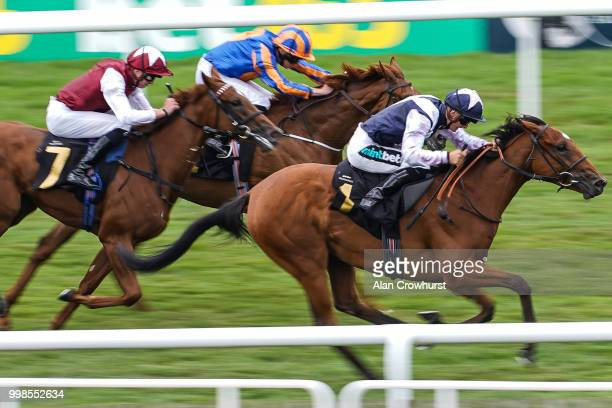 Harry Bentley riding Antonia De Vega win The Rossdales British EBF Maiden Fillies' Stakes at Newmarket Racecourse on July 14 2018 in Newmarket United...