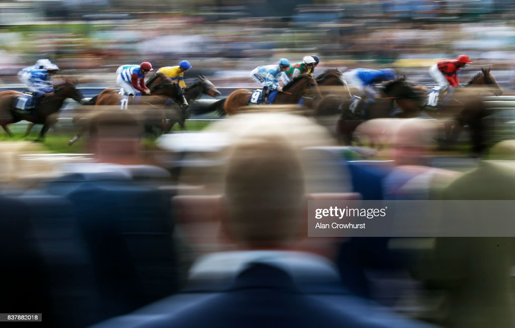 Harry Bentley riding Magic Circle (C, #9) on their way to winning The Fine Equinity Stakes at York racecourse on August 23, 2017 in York, England.