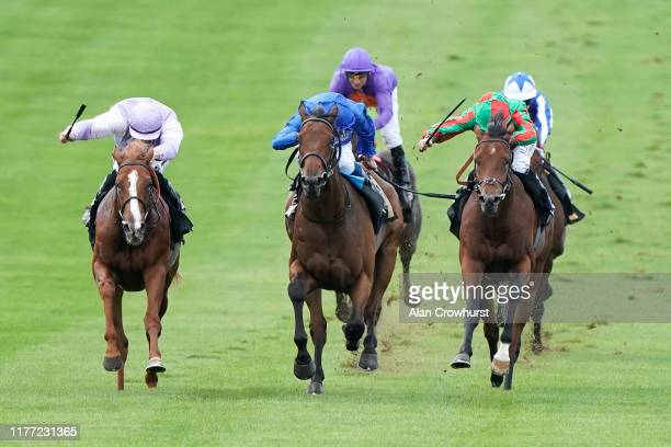 Harry Bentley riding Mascat win The Heath Court Hotel British EBF Maiden Stakes from William Buick and Discovery Island at Newmarket Racecourse on...