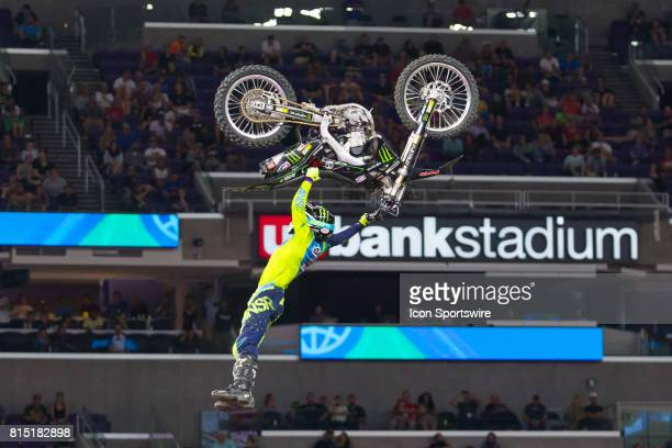 Harry Bink dangles from his bike for his 2nd run during Moto X Freestyle at X Games Minneapolis on July 14 2017 at US Bank Stadium in Minneapolis...