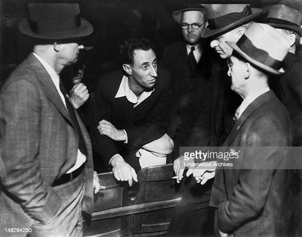 Harry Bridges labor leader in San Francisco in a discussion with businessmen San Francisco California circa 1936