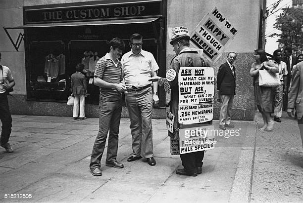 Harry Britton founder of the 'International Association of Dissatisfied Husbands' campaigns for 'Husband Liberation' on Fifth Avenue New York May 1980