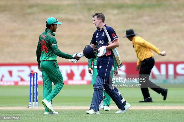 Harry Brook of England is congratulated by Afif Hossain Dhrubo of Bangladesh after reaching his century and winning the match during the ICC U19...