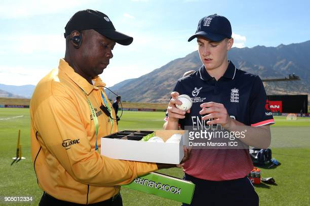 Harry Brook of England selects a match ball ahead of the ICC U19 Cricket World Cup match between England and Namibia at John Davies Oval on January...