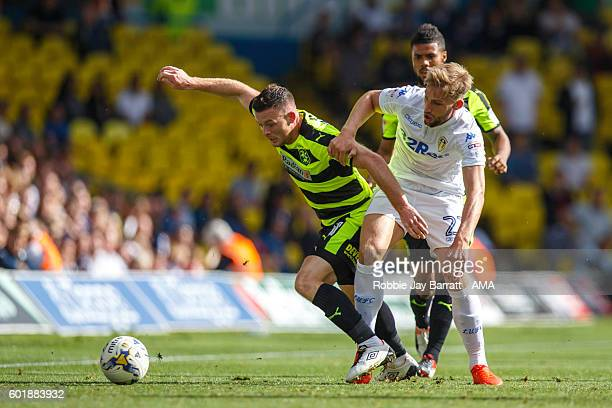 Harry Bunn of Huddersfield Town challenged by Charlie Taylor of Leeds United during the Sky Bet Championship fixture between Leeds United and...