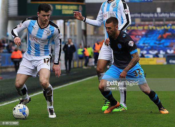 Harry Bunn of Huddersfield Town FC under pressure from Jack Hunt of Sheffield Wednesday FC during the Sky Bet Championship match between Huddersfield...