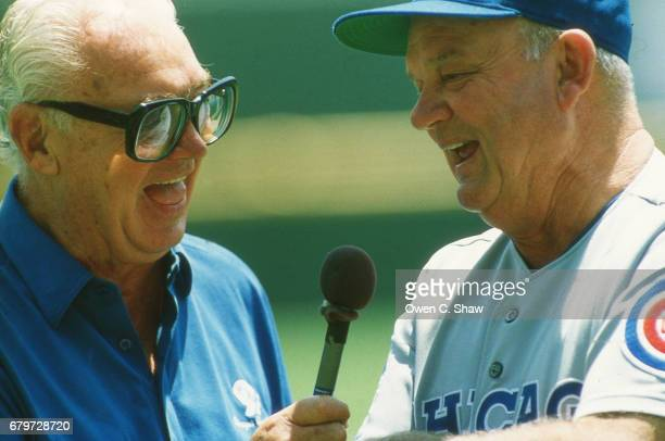 Harry Caray broadcaster for the Chicago Cubs and coach Don Zimmer circa 1985 at a game against the San Diego Padres at Jack Murphy Stadium in San...