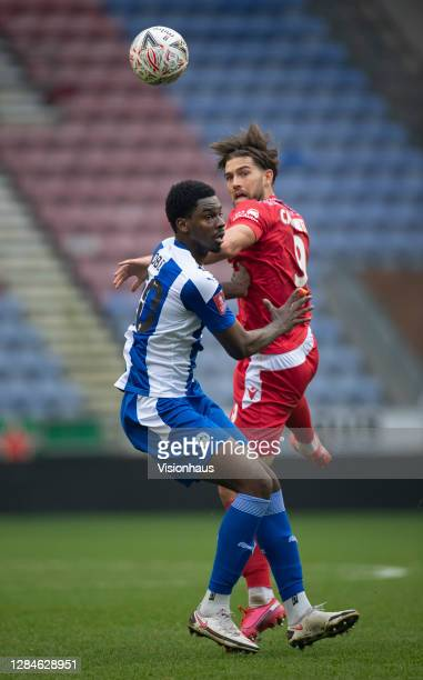 Harry Cardwell of Chorley FC and Emeka Obi of Wigan Athletic in action during the FA Cup First Round match between Wigan Athletic and Chorley on...