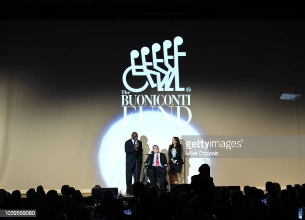 Harry Carson Marc Buoniconti and Stephanie Sayfie Aagaard speak on stage during the 33rd Annual Great Sports Legends Dinner which raised millions of...