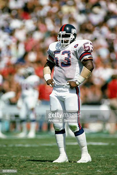 Harry Carson of the New York Giants stands on the field during a game in September of 1986