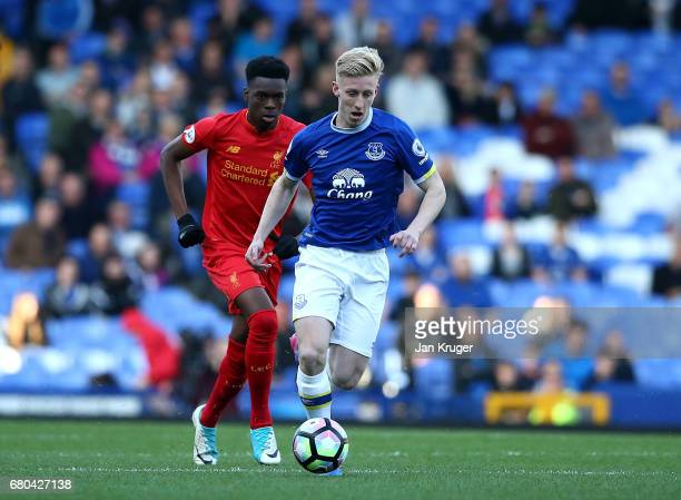 Harry Charsley of Everton controls from Ovie Ejaria of Liverpool during the Premier League 2 match between Everton and Liverpool at Goodison Park on...