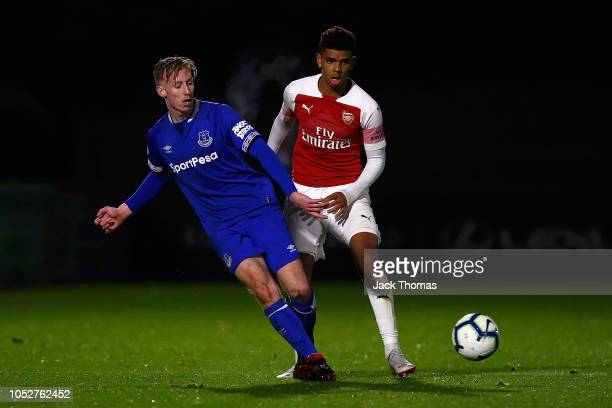 Harry Charsley of Everton is challlenged by Tyreece John Jules of Arsenal during the Premier League 2 match between Arsenal and Everton at Meadow...