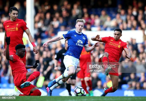 Harry Charsley of Everton is tackled by Joe Gomez and Trent Alexander Arnold of Liverpool during the Premier League 2 match between Everton and...