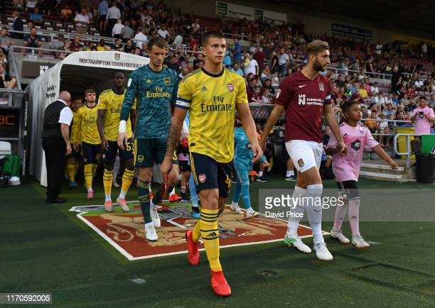 Harry Clarke of Arsenal leads out the team before the Leasingcom match between Northampton Town and Arsenal U21 at PTS Academy Stadium on August 27...