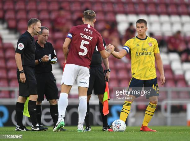 Harry Clarke of Arsenal shakes hands with of Charlie Goode of Northampton before the Leasingcom match between Northampton Town and Arsenal U21 at PTS...