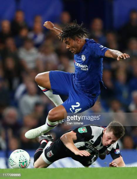 Harry Clifton of Grimsby Town tackles Reece James of Chelsea during the Carabao Cup Third Round match between Chelsea FC and Grimsby Town at Stamford...
