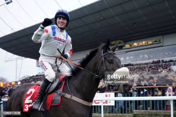 Harry Cobden celebrates after riding Clan des Obeaux to win The 32Red King George VI Chase at Kempton Park on December 26 2018 in Sunbury England