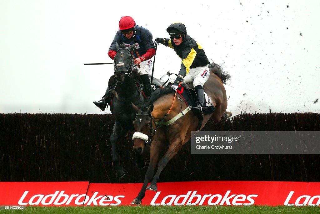 Harry Cobden jumps the last on Elegant Escape ahead of Bryony Frost on Black Cotton to win The Ladbrokes John Francome Novies' Steeple Chase as Newbury Racecourse on December 2, 2017 in Newbury, United Kingdom.