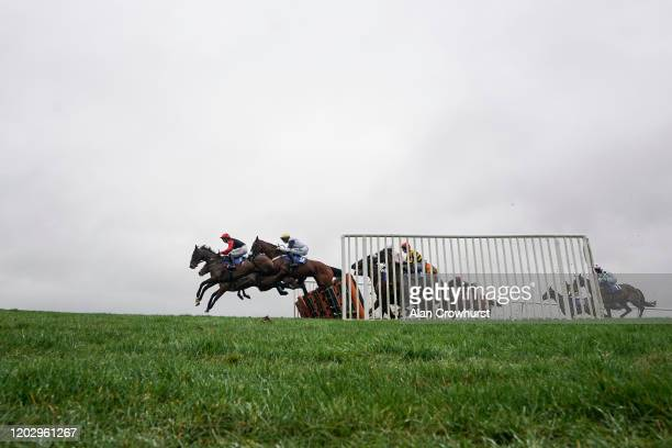 Harry Cobden riding Cill Anna clear the first flight of hurdles on their way to winning The Molson Coors EBF Mares' 'National Hunt' Novices' Hurdle...