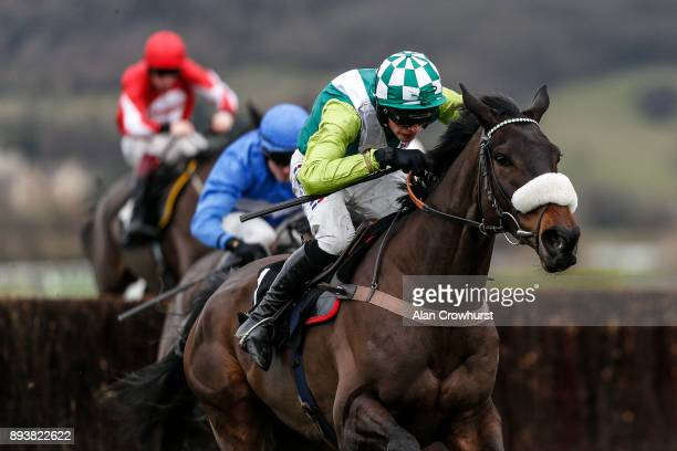 Harry Cobden riding Clan Des Obeaux in action at Cheltenham racecourse on December 16 2017 in Cheltenham United Kingdom