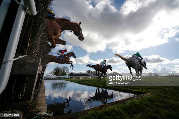 Harry Cobden riding Cucklington clear the water jump on their way to winning The Smarkets Handicap Steeple Chase at Wincanton Racecourse on March 28...