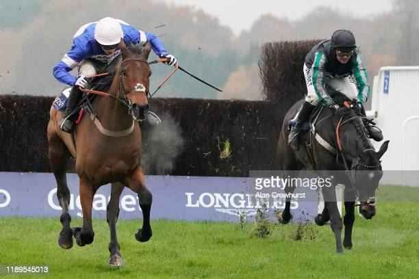 Harry Cobden riding Cyrname clear the last to win The Christy 1965 Chase from Altior and Nico de Boinville at Ascot Racecourse on November 23, 2019...
