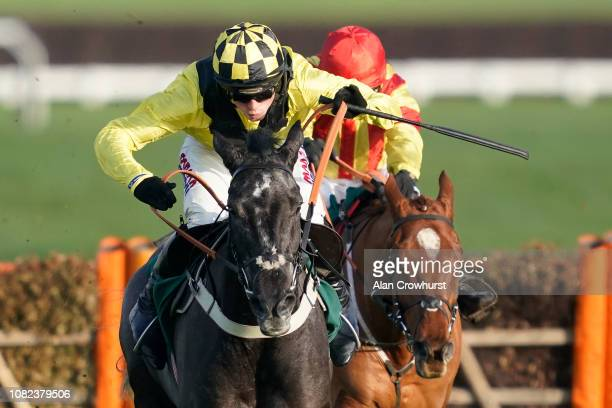 Harry Cobden riding Elixir De Nutz clear the last to win The British Stallion Studs EBF 'National Hunt' Novices' Hurdle at Cheltenham Racecourse on...