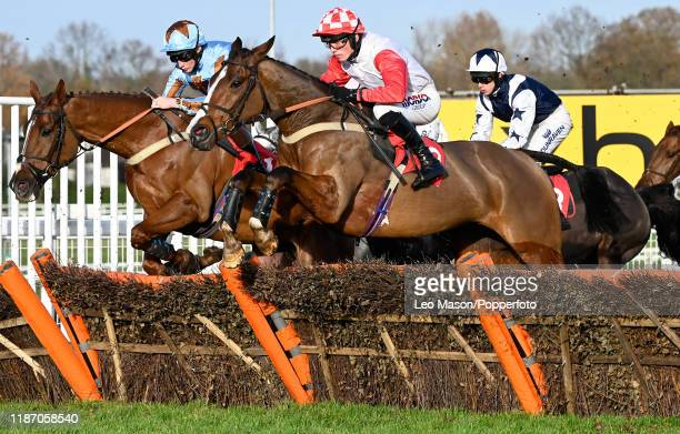 Harry Cobden riding Go Whatever en route to winning The Pertemps Network Handicap Hurdle at Sandown Park Racecourse on December 07, 2019 in Esher,...