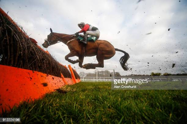 Harry Cobden riding Irondale Express clear a flight of hurdles at Lingfield Park racecourse on January 30 2018 in Lingfield England