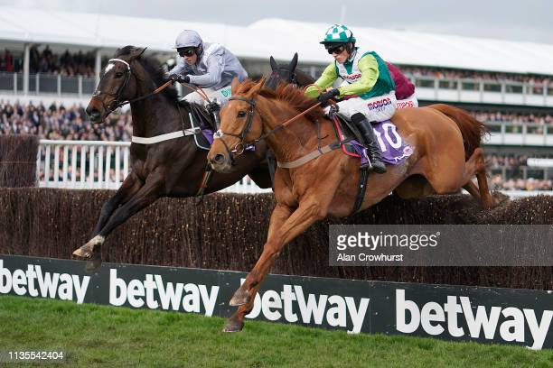 Harry Cobden riding Topofthegame clear the last to win The RSA Insurance Novices' Chase from Santini at Cheltenham Racecourse on March 13 2019 in...