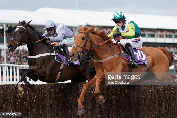 Harry Cobden riding Topofthegame clear the last to win The RSA Insurance Novices' Chase from Santini at Cheltenham Racecourse on March 13, 2019 in...
