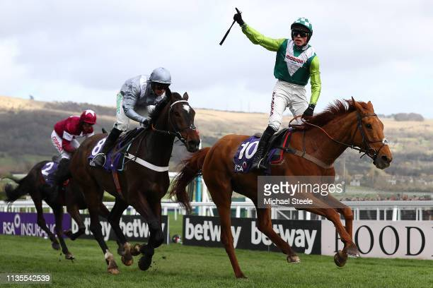 Harry Cobden riding Topofthegame wins the RSA Insurance Novices' Steeple Chase from Nico de Boinville riding Santini during the on Ladies Day of the...