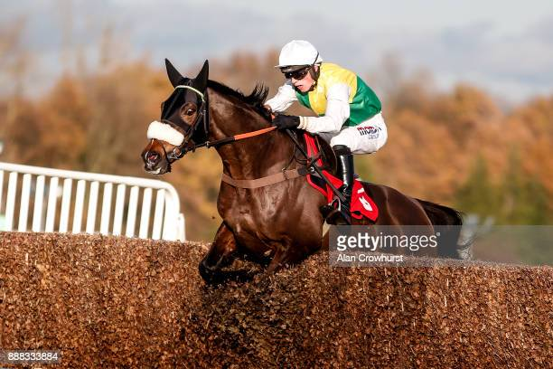 Harry Cobden riding Touch Kick clear the last to win The MS Amlin Insurance Novicesâ Limited Handicap Steeple Chase at Sandown Park racecourse on...