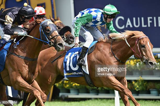 Harry Coffey riding Tuscan Sling wins Race 8 the Cup Club Christmas Stakes during Melbourne Racing at Caulfield Racecourse on December 26 2015 in...