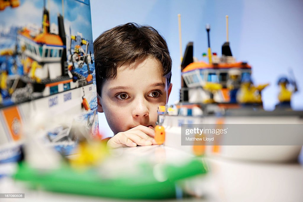 Harry Collett, (9), plays with a Lego Coastguard Patrol set at a media event at St Mary's Church in Marylebone on November 6, 2013 in London, England. The Toy Retailers Association's Dream Toys chart, is an independent list of the predicted Christmas top 12 best-selling gifts for children.