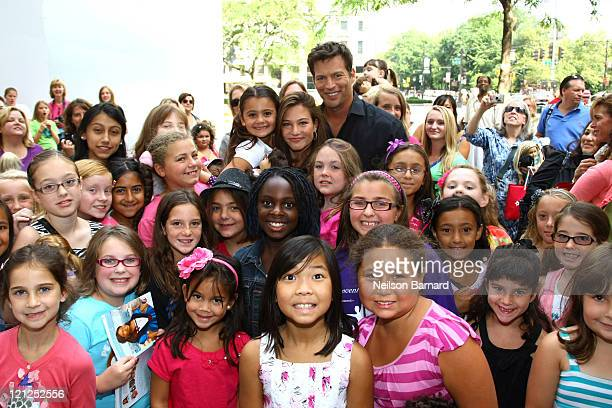 Harry Connick Jr and daughter Kate Connick visit with fans during their appearance to perform a song for New Orleans at CBS Early Show Studio Plaza...