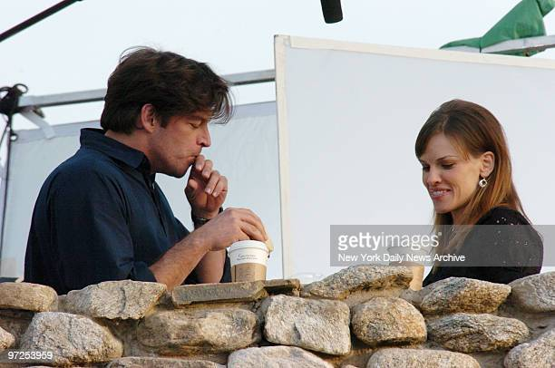 Harry Connick Jr and Hilary Swank drink coffee at the Irish Hunger Memorial in Battery Park City where they are filming scenes for their new movie PS...