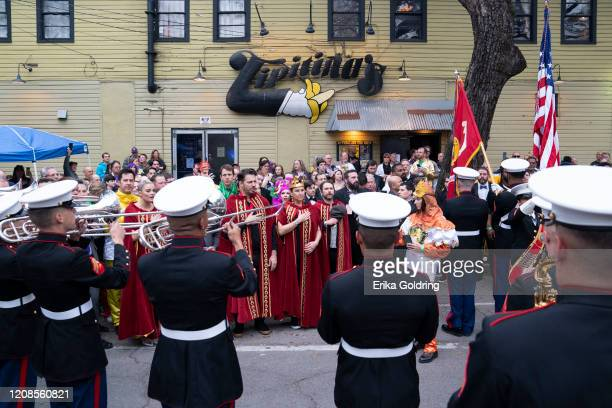Harry Connick Jr and Jill Goodacre Connick sing the national anthem before the 2020 Krewe of Orpheus parade on February 24 2020 in New Orleans...