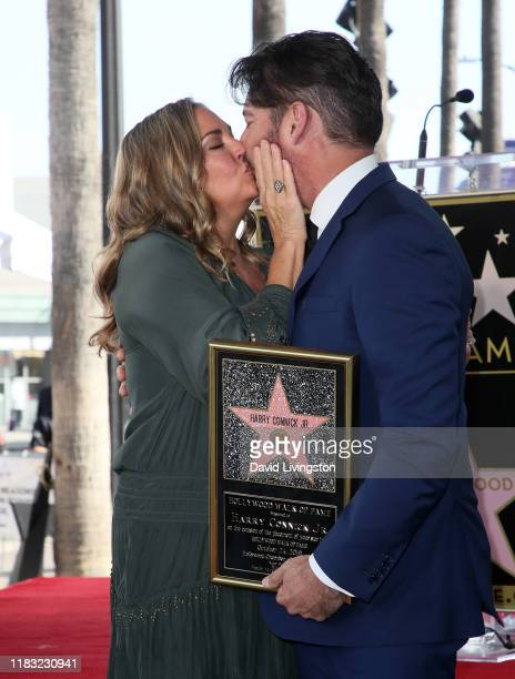 Harry Connick Jr and wife Jill Goodacre attend as he is honored with a Star on Hollywood Walk of Fame on October 24 2019 in Hollywood California