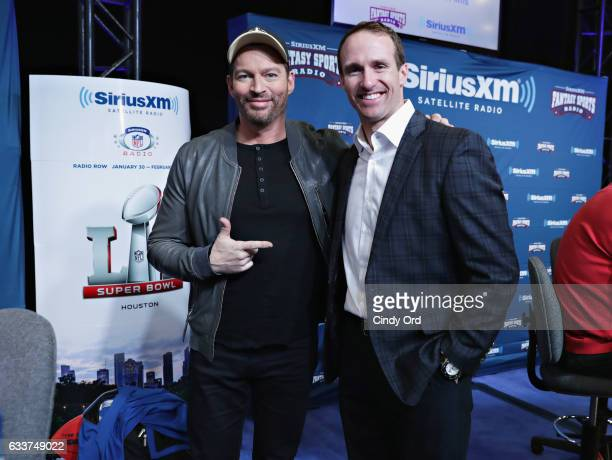 Harry Connick Jr left and New Orleans quarterback Drew Brees visit the SiriusXM set at Super Bowl LI Radio Row at the George R Brown Convention...