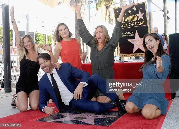 Harry Connick Jr poses with his wife Jill Goodacre Connick and daughters Georgia Connick Charlotte Connick and Sarah Connick during a ceremony...