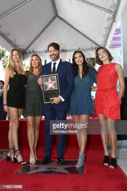 Harry Connick Jr poses with his wife Jill Goodacre Connick and daughters Georgia Connick Sarah Connick and Charlotte Connick during a ceremony...