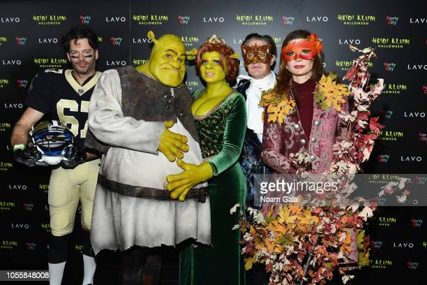 Harry Connick Jr., Tom Kaulitz, Heidi Klum, Kyle MacLachlan, and Desiree Gruber attend Heidi Klum's 19th Annual Halloween Party presented by Party...