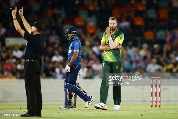 Harry Conway of the Australian PMXI reacts after bowling during the T20 warm up match between the Australian PM's XI and Sri Lanka at Manuka Oval on...